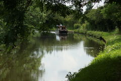 Canal Boat on Canal. A Canal Boat on a Picturesque Canal Scene Royalty Free Stock Photography