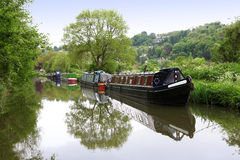 Canals in united kingdom with boats, bridges and v. Egetation Royalty Free Stock Photos
