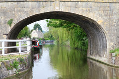 Canals in united kingdom with boats, bridges and v. Egetation stock photos