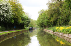 Canals in united kingdom with boats, bridges. And vegetation Royalty Free Stock Images