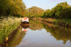 Canals in united kingdom with boats, bridges and v. Egetation Royalty Free Stock Images