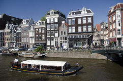 Canal Boat and Houses Amsterdam Stock Photography