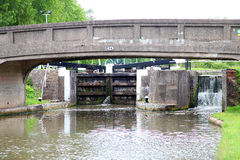 Canal lock and bridge in united kingdom Stock Photos
