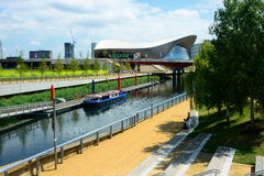 Canal boat and London Olympic aquatic building Royalty Free Stock Photo