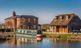 Canal boat moored alongside country house in Devizes, Wiltshire, UK stock image