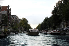 Canal Boat Tour in Amsterdam, Netherlands Royalty Free Stock Images
