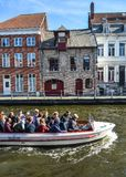 Canal boat tour in the Old Town of Bruges royalty free stock photography