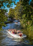Canal boat tour in the Old Town of Bruges stock photography