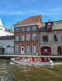 Canal boat tour in the Old Town of Bruges stock images