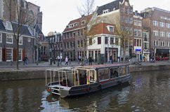 Canal boat tour in red light district Amsterdam Stock Photography