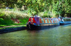 Canal Boats on the Shropshire Union Canal. Colorful canal, house boats on the Shropshire Union Canal, moored at the side of the canal stock image