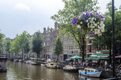 Canal with boats in Amsterdam Stock Photography