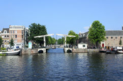 Canal with boats in Amsterdam. A view of boats on the canal in harbor on 26 July 2014 in Amsterdam, The Netherlands Stock Images