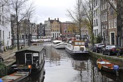 Canal boats in autumn in Amsterdam, Holland Stock Photography