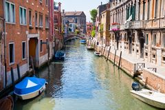 Canal, boats and bridge in Venice Stock Photo