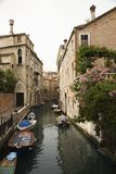 Canal with boats and buildings in Venice. Royalty Free Stock Photography