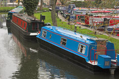 Canal boats docked. Various colored canal boats in dock Stock Photos