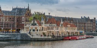 Canal boats in front of the Restaurant in front of the Central station in Amstedam Stock Image