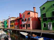 Canal with boats and homes of many colors in Burano in Venice in Italy Royalty Free Stock Photos