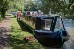 Canal Boats. A line of narrowboats moored along a sunny stretch of the Grand Union Canal at Linslade, Bedfordshire, UK Royalty Free Stock Photos