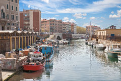 Canal with boats in Livorno, Tuscany, Italy Stock Photography