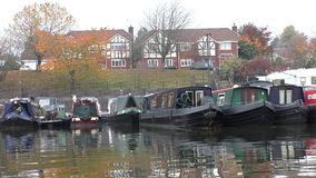 Canal boats in marina in autumn stock video footage