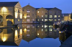 Canal and Boats at Night. Canal, boats and old mill illuminated at dusk. Taken at Shire Cruises, Sowerby Bridge, Halifax Stock Photos