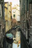 Canal boats and reflections Venice Italy stock image