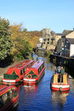 Canal boats on Springs Canal, Skipton, Yorkshire. Looking along Springs Canal, a short branch off the Leeds and Liverpool Canal in Skipton, North Yorkshire with Royalty Free Stock Photography