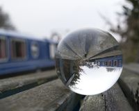 Canal boats taken through a glass sphere stock photography