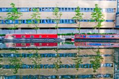 Canal boats, trees and building royalty free stock photo