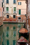 Canal and boats, Venice, Italy. Side canal with boats and behind in background, venice, italy Royalty Free Stock Images