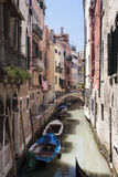 Canal with boats in Venice Stock Images