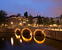 Canal With Bridge In Amsterdam At Night Stock Photography