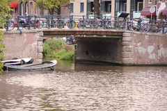 Canal bridge in Amsterdam. Old pedestrian and bicycle bridge over a canal in Amsterdam Royalty Free Stock Photo