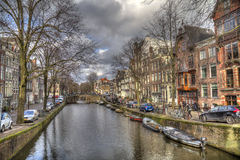 Canal and bridge in historical Amsterdam, Holland Stock Photos