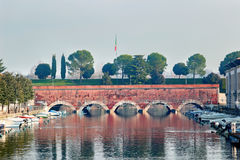 Canal with bridge in the historical Peschiera del Garda, Italy. Royalty Free Stock Image