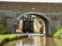 Canal bridge with lock. Bridge with bottom gate of a canal lock on the Shropshire Union Canal near Audlem in Cheshire, England Stock Images