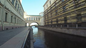 Canal and bridge near Hermitage. RUSSIA, SAINT PETERSBURG, JULY, 2016: Winter Canal - Canal at Central district of St. Petersburg, connecting Great Neva and stock video footage