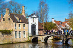 Canal and bridge view, St. Elisabeth Church entrance in Brugge, Belguim Royalty Free Stock Photography