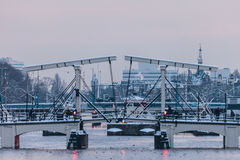 Canal bridge during wintertime in Amsterdam Royalty Free Stock Photos