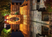 Canal in Bruges. Night shot of historic medieval buildings along a canal in Bruges, Belgium, which is on the world heritage list of unesco Royalty Free Stock Photography