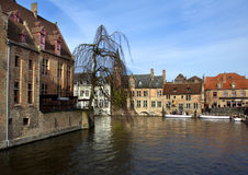 Canal in Bruges. Canal with shops, restaurants, and boats in Bruges, Belgium Royalty Free Stock Images