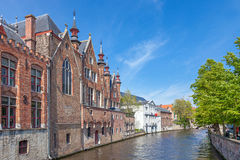 Canal in Bruges with an ancient red brick building Stock Image