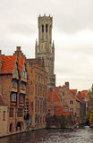 Canal in Bruges (Belgium). Canal, historic buildings and the tower of the city hall in the old town of Bruges (Belgium Royalty Free Stock Image