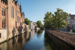 A canal in Bruges, Belgium. A medieval canal in Bruges, Belgium, in summertime, with no one around Stock Images