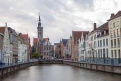 Canal of Bruges with Church, Belgium Stock Photo