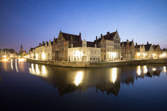 Canal Reflections in Bruges At Night. Canal in Bruges At Night with illuminated waterfront houses Royalty Free Stock Photos