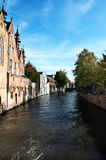 Canal in Brugge, Belgium. Beautiful view of a canal and blue sky, from bridge,  Bruges, Belgium Stock Images