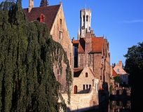 Canal and buildings, Bruges, Belgium. Canalside houses and the belfry in early morning light seen from Rozenhoedkaai, Bruges, Belgium, Europe Royalty Free Stock Photography